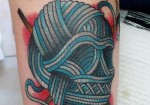 knit-fast-die-warm-kniiting-skull-tattoo-on-half-sleeve